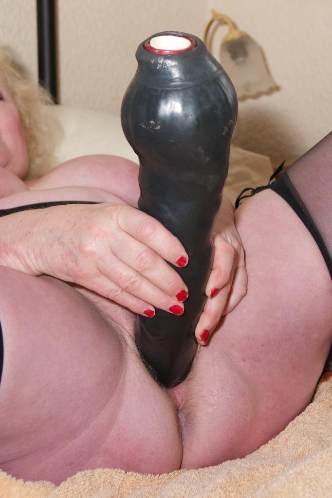 Precisely she uses a dildo
